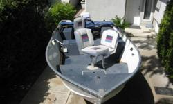 Lowe 16 foot Aluminum fishing boat. 40 HP Evinrude, Tiller, trim, tilt, electric start. Livewell, bilge system. Casting platform, 3 pedestal seats. Bimini top. Carpeted. Accessories. Good shape.