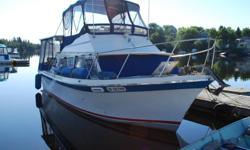 32 foot luhrs FB cruiser Twin 318's inboard v-drives with 50 hrs, rebuilt in 2002, new shafts, props struts and rudder with new stuffing boxes.  Sleeps 5 fridge/freezer stove, oven. Hot and cold water shower, electric head. All enclosed with canvas