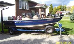 Lund Mr. pike 18.5 ft. dual console with a 2007 115hp. Evinrude Etec engine. Shorelander bunk style trailer with brakes. Boat comes loaded with minkota trolling motor, 3 batteries, on board battery charger, auto timed aerated livewells, pro capacity in