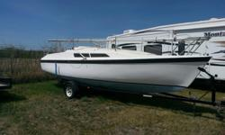 1992 MacGregor 26s with main and 2 jibs,8hp tohatsu, porta potti, cushions and accessories.