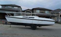 Macgregor 26S sailboat. Well cared for. 6 ft swing keel only draws 1.5 ft when pulled up. 1200 lb water ballast system with 9.9 hp motor. Trailer, New jib, batten main, Can sleep 5, toilet, sink, stereo, CB radio, compass, and all safety equipment.