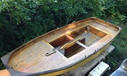 Classic design, small wooden sail boat. Includes rigging, sails and trailer. In need of some repairs.