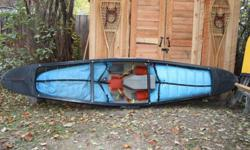"Mohawk Probe 11 Solo Whitewater Canoe.Royalex construction. Length 11'8"". Comes fully outfitted with foam saddle, knee pads, thigh straps, floatation bags.  Excellent condition and ready to paddle.  Sharp lines means great carving, wave surfing, edging"