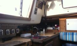 "The BIG 25' sailboat. (9'-1"" beam) 9.8 Merc (long shaft) with electric start, sails are good. (1 main, 2 jibs) steel cradle (08). full galley, new marine heads last 2009, 5"" cushions are very comfortable for sleeping. Info sheet, more photos (with before"