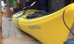 """Bow and stern hatches, retractable skeg, yellow polyethylene, 52 lbs, 14'4"""" long. See stats here: http://www.neckykayaks.com/kayaks/day_touring/manitou_14/ Used less than half a dozen times. Stored outside but covered for its whole life, always with a"""