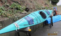 """Stable, reliable, solid fiberglass touring kayak 17"""" in length; approx 60 lbs. New keel strip, seat & rudder cables in 2015 Excellent condition. Cockpit cover included. This boat is looking for a new home!"""