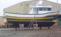 """NEW""  36' FIBERGLASS/Wood fishing vessel, c/w 208hp, GM, Detroit diesel, less than 1000hrs, 3-to-1 reduction gear, 1-DVHF, 1-GPS, 1,000watt Raytheon sounder, all new, $50,000, Call (709) 884-7702 Twillingate(Central)"
