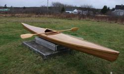New cedar strip Kayak, hand made paddle