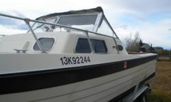 PENN YAN TUNNEL DRIVE BOAT 21 FOOT AND TRAILER Benches/couches in very good condition, Hydrolic power lifters, Toilet, Fish Storage, Billage Pump, Sleeps 4, Can operate in 18 inches of water due to tunnel drive, 225 Chrysler engine and Only 51 hours of
