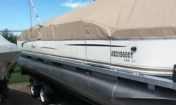 24' Tahoe Pontoon Boat c/w Trailer and 90 HP Yamaha 4 Stroke Motor.  Price reduced to sell now.  Beautiful and comfortable for cruising the large lakes.
