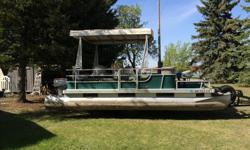 Harris Flote Bote, 8ft. x 16ft. deck. 20ft. pontoons, canopy, 5 swivel seats plus 2 bench. 25hp Johnson electric start motor in good condition. Canvas custom built cover. New tires (2015) and spare. Located in Yorkton. Asking 7,000.00 Ph. (306)547-7618