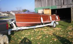 1950 Port Carling Seabird classic wooden boat, 20 ft. 6 cyl, 105 HP engine in excellent condition Upholstery recently redone and in excellent condition Comes with EZ loader trailer All in very good condition