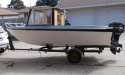 16 foot fiberglaas project boat with 65 HP Mercury for sale. $1800 OBO. Need to sell it due to health issues.