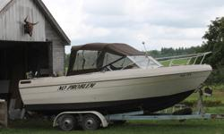 21 foot Bayliner with cuddy cabin very deep hull it has fish box and ice box sink and a toilet a 6 ft high roof with storm doors for the cold weather and a full canvas cover for it when it is parked or for the winter,and tandom trailer in good condition