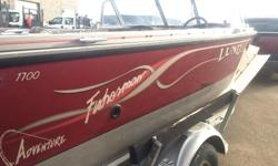2001 Lund 1700 Fisherman Boat with two stroke, oil injected 135 hp Evinrude motor (sorry, don't know how many hours). The boat has tilt steering, a full windshield, three seats - transferrable to five seat locations, two live wells, bait well/cooler, side