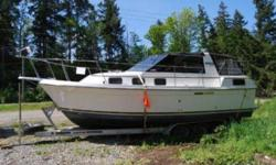 Description: 28' Carver Riveria with tripple axel I beam aluminum trailer.twin 305's with low  hours, new canvas, and very clean .With her 11' beam and aft cabin she sleeps 6-8. this is one classy boat. Contact Guy's Boats for more details.... REDUCED