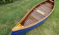 Vintage 16' Peterborough #1492 Champlain wood/canvas canoe. Circa 1940. Documentated complete restoration receintly completed. Unused since. Show quality. Matching vintage paddles available. Truly must see to appreciate. More pictures available.