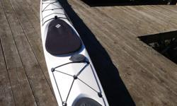 """This is a Reval Viking sea kayak by Tahe Marine. It is in """"like new"""" condition and it has been used only a few times. It is made of fiberglass and it is approximately 19' long and 22"""" wide. The kayak weighs about 55 pounds and comes with a factory rudder."""