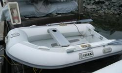 Titan 8 ft. 6 in. dinghy. Excellent condition. + inflator + cover. 2 hp. Honda outboard. Runs extremely well.