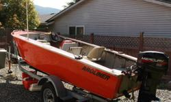 17 foot riveted aluminum Aroliner with 25HP 2-stroke Mercury outboard motor on a Roadrunner single-axle boat trailer (wired for lights). Front-mounted steering wheel and throttle, Garmin fish finder/depth sounder, marine radio and antenna. Boat is started