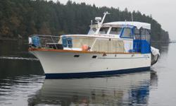 Designed by Ed Monk as a long range cruiser featuring a semi displacement hull with a full length keel for comfortable stable and safe cruising. Powered by a Perkins diesel engine with under 1400 hours of use she cruises at 7-8 knots burning only two