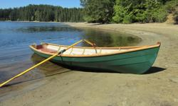 John Welsford designed 'Joansa'. This is a sleek and very sea-worthy rowing dinghy. The boat is 15 1/2' long by 4' wide. Weight is similar to a double kayak. This is a nicely built and well equipped rowing boat. It has brass Douglas oar