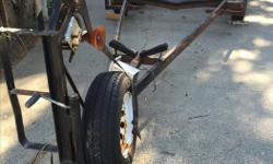 Appx 21 feet. From what I was told this was a sailboat trailer. Tires are in excellent condition. Trailer needs some work though. Lights work. Has papers.