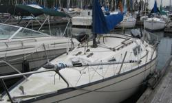 Good condition. 6 HP four stroke long shaft outboard. Two fore sails, spinnaker and main.