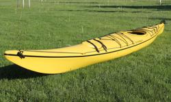 """2003 Current Designs Squall Kayak in excellent condition. 16'6"""" in length, yellow in colour. Skirt included."""