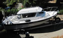 97 Seasport pilot house cabin. 350 Volvo Penta, dual prop. Aluminum I beam trailer