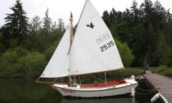 12ft sf pelican, 16 ft with bowsprit . sails and rigging in good condition. pivoting centerboard, spar and gaff of sitka spruce. lots of fun ,very stable, great for family outings ,quite roomy.