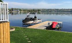 ShoreMaster vertical boat lift. 4000lbs capacity. Optional full length side guide rails. Comes complete with LiftTech direct drive solar winch with two remote key fobs. 15W solar panel, battery tray, battery, and battery box also included. Lift is 3 years