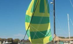 Green and yellow Symetrical Spinnaker for sale; 1 oz nylon cloth - great physical shape, rarely used and stored in socks.  Age approximate.  This sail would be $5000 new!  48 foot leech (side) lenths x 28 foot at foot (bottom).  For use on sailboat with