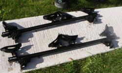 Sportrack main rail system, 2 sets of kayak cradles and 3 bike racks. Excellent rack system that can be used with other sportrack accessories (skis, snowboard). This set is for a vehicle with raised roof rails. It is a key locking system. All straps