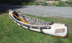 A Lovingly cared for legendary Sports Pal canoe. Aviation grade aluminum construction still wearing the original factory paint. Comes with motor mount for trolling motor; original factory seats with small water-proof compartment and original paddles. A