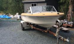 14 Foot FIberglass boat on easy load trailer. 55 hp Evinrude motor with extra parts, motor runs great $1800 O.B.O.