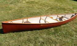 16' Swift Quetico Kevlar canoe. Top made of one piece black cherry from wilberforce ontario. Handcrafted by a builder in Algonquin park. Seats and rails made of ash . Front slider seat for leg length adjustment. Hand carved custom  neck yolk for