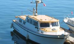 I have a beautiful classic wooden trawler-style cabin cruiser for sale or exchange.  She's a 1970 38-ft cruiser powered by a reliable 120 hp Ford Lehman diesel engine.  Has berths for 4, a fully-equipped galley, diesel central heating and all necessary