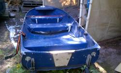 14ft aluminum boat, light weight, fold up wheels on transom, rod holders