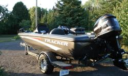 2007 Tracker Avalanche, 18.5' with 115 OPT Mercury Motor and Tracker Marine Trailer. Fish finder, Trolling Motor and Safety equipment included. Boat and Trailer like new, never used, only 14 hours on boat. $18,000 firm.