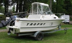 Perfect Fishing Machine.  20' Trophy with cuddy cabin and walkaround (measures 22') 125 Mercury in mint condition. Escort galvanized trailer with surge brakes in new condition. One owner retired couple (package has less than 1000 hours in freshwater