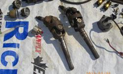 ( NOT COMMERCIAL ) THESE 140 MERCRUISER YOKE ASSEMBLIES ARE IN VERY GOOD CONDITION @ $50. EA... 140 IGNITION COILS W / BRACKETS ( PRIMARY / SECONDARY WINDINGS TESTED CORRECT ) $10. EA.... GOOD WORKING DISTRIBUTOR W / NEW LEADS $60.... 140 FIRE ARRESTOR