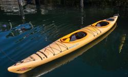 """Victoria Kayak is making way for the 2017 inventory! Now Selling: Current Designs """"Double Vision"""" Double Kayak with Rudder (2013 model year) - Mango color. These Roto Molded kayaks are pretty much indestructible. You won't need to worry about beaching or"""