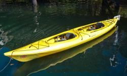 """Victoria Kayak is making way for the 2017 inventory! Now Selling: Necky """"Manitou II"""" Double Kayak with Rudder (2010 model year) - Yellow color. These Roto Molded kayaks are pretty much indestructible. You won't need to worry about beaching or dragging"""