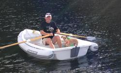 - 10' rigid/inflatable with beautiful wood oars - motors beautifully with outboard, rows like butter with oars - includes inflatable tubing around perimetre of boat, which makes it virtually untippable - stored on land - only very lightly used