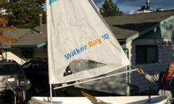 Walker Bay Fishing/Sail Boat for sale including boat, sail, oars, MinnKota electric motor, 4 HP Yamaha engine, and boat trailer.