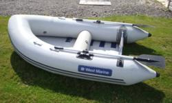 West Marine inflatable with pump oars and carry bag.$500.00