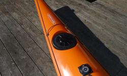 "This is a Wind 535 sea kayak by Tahe Marine. It is in new condition and it has been used only once. It is made of fiberglass and it is approximately 17 1/2 feet long and 23"" wide. The kayak weighs about 55 pounds and comes with a factory installed rudder"