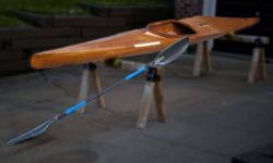 18ft. wooden racing Lancer used in 1976 olympics Includes Flite paddle collectors item in good condition. stored for the past 20 years raced at the Cheema Canoe Club Dartmouth in 1990