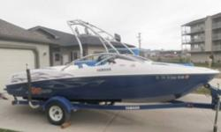 The AR210 is a versatile bowrider that's designed for the active family that loves water activities. She doubles as a wakeboarding boat and comes with many added features you wouldn't expect to see on a 21-footer. Key Features Seating for seven Swim